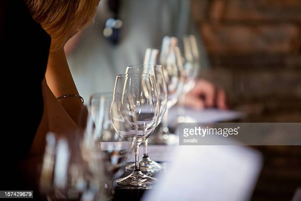 Line view of wine glasses at tasting bar