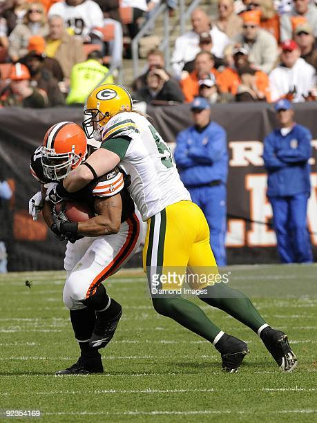 Linebacker A J Hawk of the Green Bay Packers tackles running back Jamal Lewis of the Cleveland Browns during a game on October 25 2009 at Cleveland...