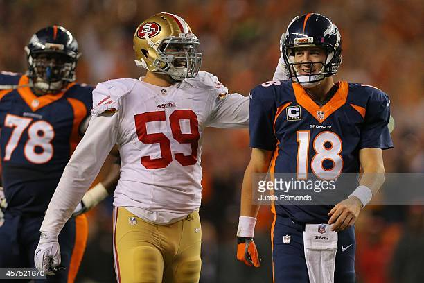 Linebacker Aaron Lynch of the San Francisco 49ers congratulates quarterback Peyton Manning of the Denver Broncos on his NFLrecord 509th career...