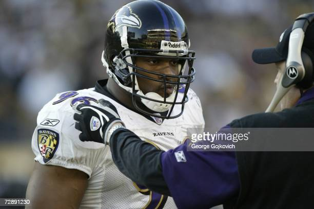 Linebacker Adalius Thomas of the Baltimore Ravens talks with defensive coordinator Rex Ryan on the sideline during a game against the Pittsburgh...