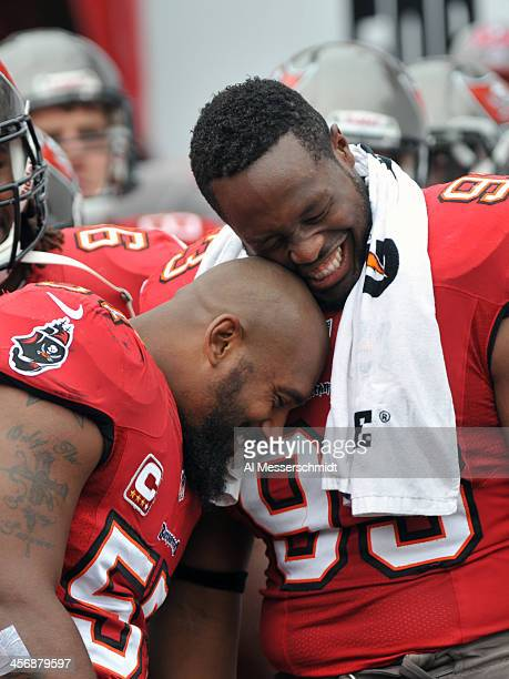 Linebacker Adam Hayward and defensive tackle Gerald McCoy of the Tampa Bay Buccaneers take the field for play against the San Francisco 49ers...