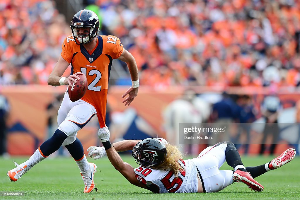 Linebacker A.J. Hawk #50 of the Atlanta Falcons attempts to tackle quarterback Paxton Lynch #12 of the Denver Broncos in the first half of the game at Sports Authority Field at Mile High on October 9, 2016 in Denver, Colorado.
