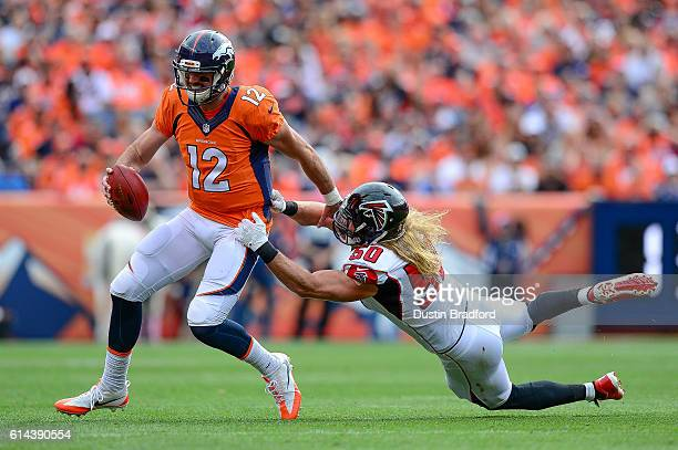 Linebacker AJ Hawk of the Atlanta Falcons attempts to tackle quarterback Paxton Lynch of the Denver Broncos in the first half of the game at Sports...