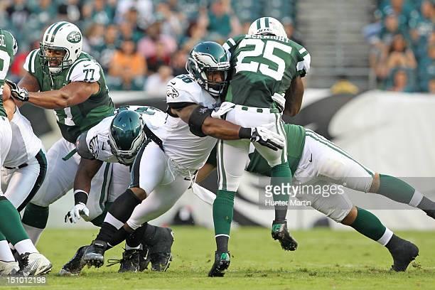 Linebacker Akeem Jordan of the Philadelphia Eagles tackles running back Joe McKnight of the New York Jets during a preseason game on August 30 2012...