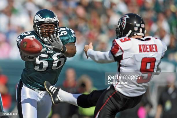 Linebacker Akeem Jordan of the Philadelphia Eagles tries to block a punt by punter Michael Koenen of the Atlanta Falcons on October 26, 2008 at...