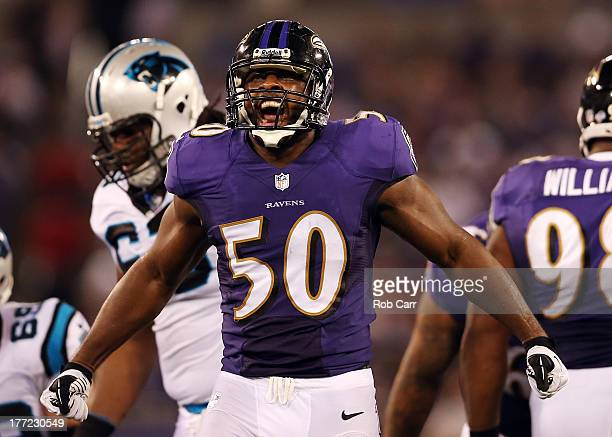 Linebacker Albert McClellan of the Baltimore Ravens celebrates after making a second half tackle against the Carolina Panthers during a preseason...