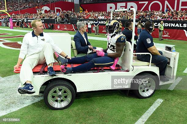 Linebacker Alec Ogletree of the St Louis Rams is carted off the field with an injury during the second half of the NFL game against the Arizona...