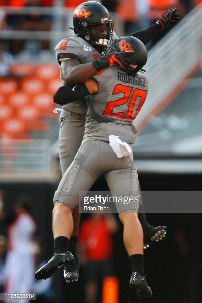 Linebacker Amen Ogbongbemiga celebrates his sack with safety Malcolm Rodriguez of the Oklahoma State Cowboys for a nineyard loss against the McNeese...