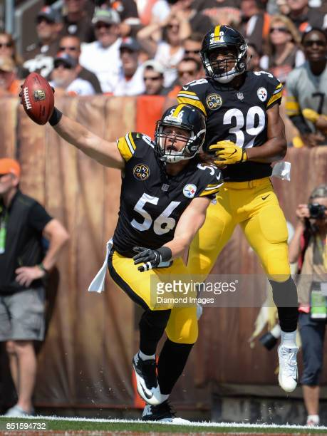 Linebacker Anthony Chickillo and running back Terrell Watson of the Pittsburgh Steelers celebrate after Chickillo recovered a blocked punt for a...