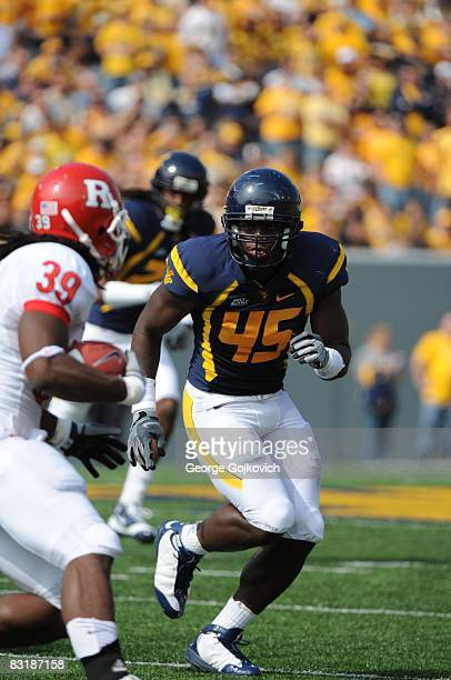 Linebacker Anthony Leonard of the West Virginia University Mountaineers pursues running back Jourdan Brooks of the Rutgers University Scarlet Knights...