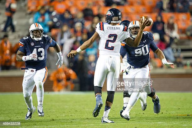 Linebacker Anthony Swain and defensive lineman Gabe Wright of the Auburn Tigers look to tackle quarterback Michael Eubank of the Samford Bulldogs on...