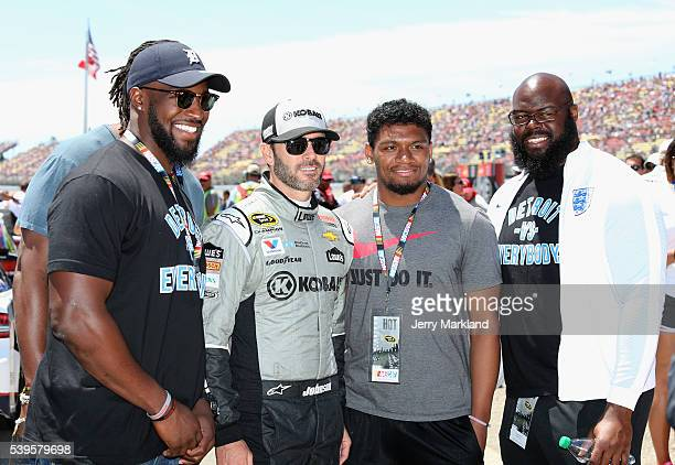Linebacker Antwione Williams, cornerback Ian Wells and defensive tackle A'Shawn Robinson of the Detroit Lions take a photo with Jimmie Johnson,...