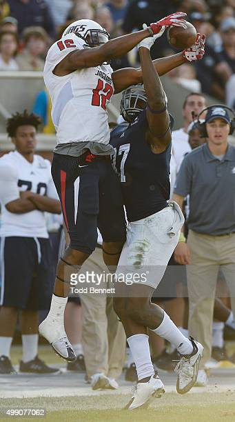 Linebacker Antwione Williams of the Georgia Southern Eagles breaks up a pass intended for tightend Gerald Everett of the South Alabama Jaguars during...