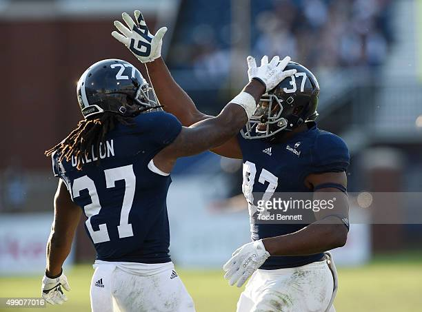 Linebacker Antwione Williams of the Georgia Southern Eagles is congratulated by teammate Ironhead Gallon after a sack against the South Alabama...