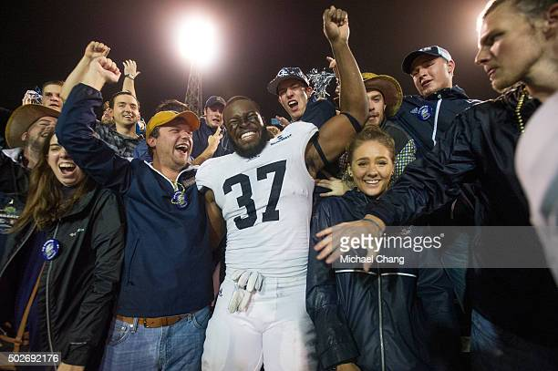 Linebacker Antwione Williams of the Georgia Southern Eagles celebrates with fans after defeating the Bowling Green Falcons on December 23, 2015 at...