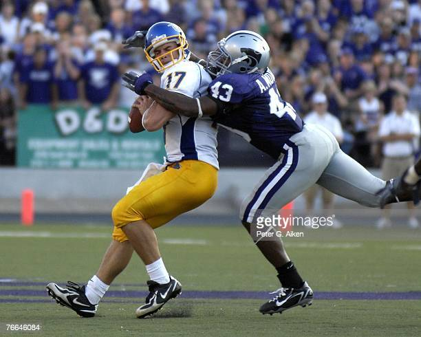 Linebacker Antwon Moore of the Kansas State Wildcats sacks quarterback Adam Tafralis of the San Jose State Spartans during a NCAA football game...