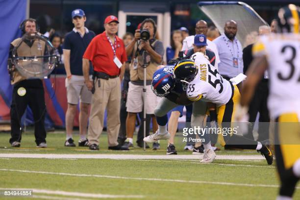 Linebacker Arthur Moats of the Pittsburgh Steelers makes a stop against the New York Giants during an NFL preseason game at MetLife Stadium on August...