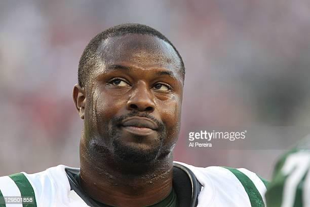 Linebacker Bart Scott of the New York Jets stands on the sideline against the New England Patriots at Gillette Stadium on October 9 2011 in Foxboro...