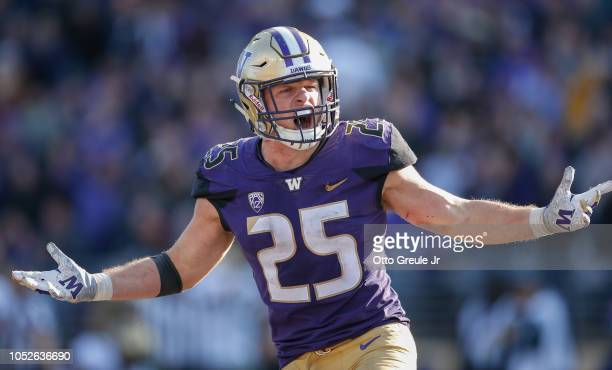 Linebacker Ben BurrKirven of the Washington Huskies reacts after making an interception in the fourth quarter against the Colorado Buffaloes at Husky...