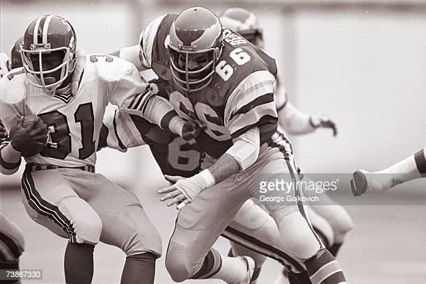 Linebacker Bill Bergey of the Philadelphia Eagles tackles running back William Andrews of the Atlanta Falcons at Veterans Stadium on December 7 1980...
