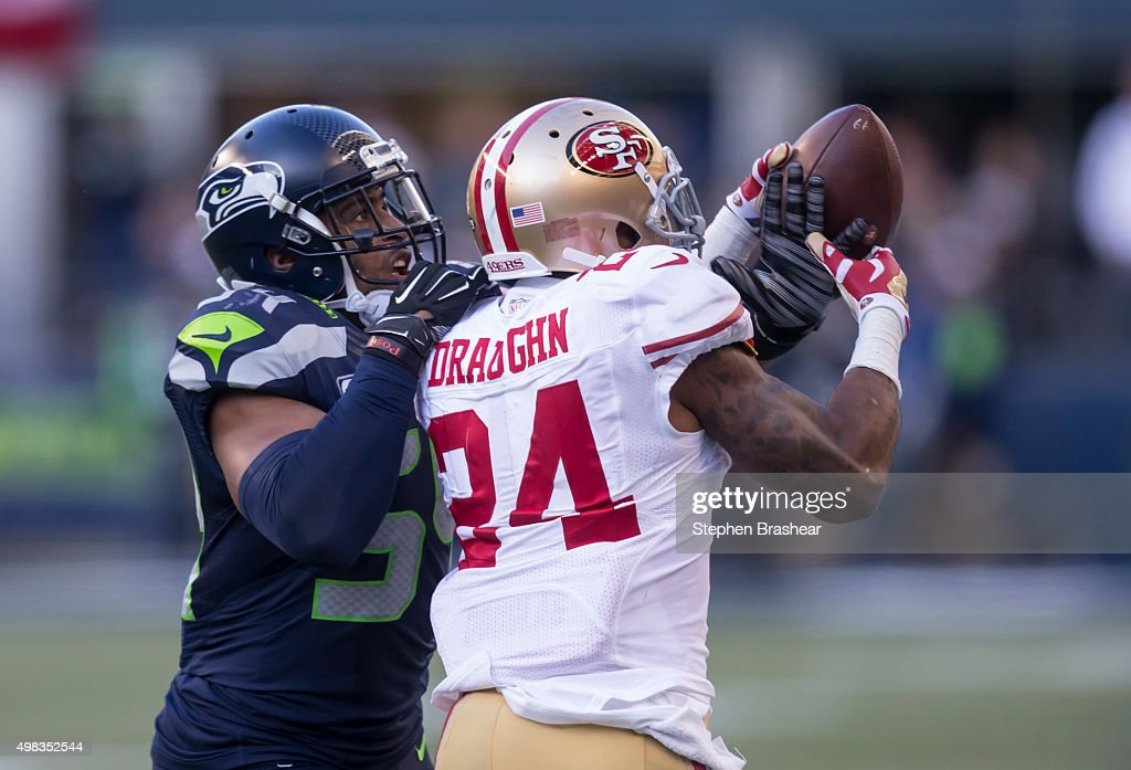 Linebacker Bobby Wagner #54 of the Seattle Seahawks knocks the ball awar from running back Shaun Draughn #24 of the San Francisco 49ers during the first half of a football game at CenturyLink Field on November 22, 2015 in Seattle, Washington. The Seahawks won the game 29-13.
