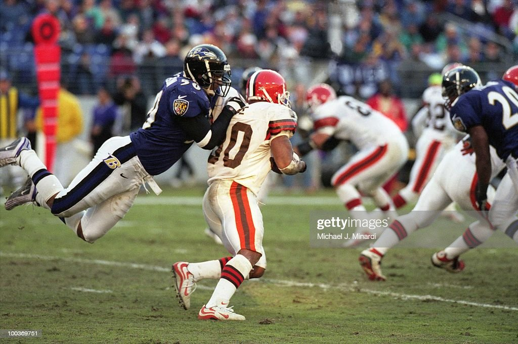Linebacker Brad Jackson #50 of the Baltimore Ravens was putting a flying tackle on Running Back Jamel White #30 of the Cleveland Browns at PSINet Ravens Stadium on November 26, 2000 in Baltimore, Maryland. The Ravens won the game 44 to 7.