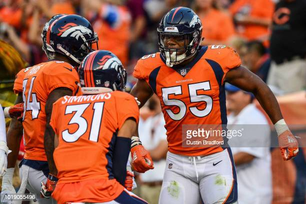 Linebacker Bradley Chubb of the Denver Broncos celebrates with defensive back Justin Simmons and defensive back Will Parks after a tackle in the end...