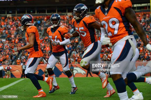 Linebacker Bradley Chubb of the Denver Broncos celebrates with defensive back Justin Simmons defensive back Will Parks and defensive back Bradley...