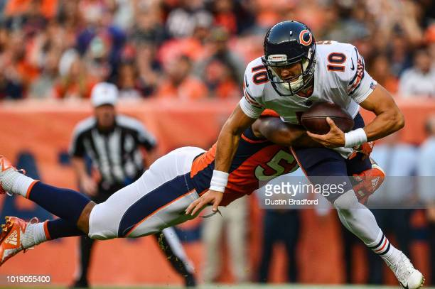 Linebacker Bradley Chubb of the Denver Broncos hits quarterback Mitchell Trubisky of the Chicago Bears in the end zone for a first quarter safety...