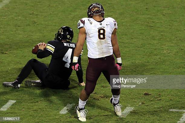 linebacker Brandon Magee of the Arizona State Sun Devils celebrates after sacking quarterback Jordan Webb of the Colorado Buffaloes at Folsom Field...