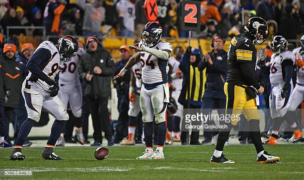 Linebacker Brandon Marshall of the Denver Broncos celebrates with defensive lineman Malik Jackson after Marshall intercepted a pass thrown by...