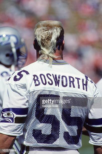 Linebacker Brian Bosworth of the Seattle Seahawks looks on from the sideline during the game against the Denver Broncos at Mile High Staduim on...