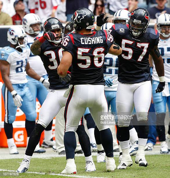 Linebacker Brian Cushing Kevin Bentley and cornerback Jason Allan during game action against the TennesseeTitans at Reliant Stadium on November 28...