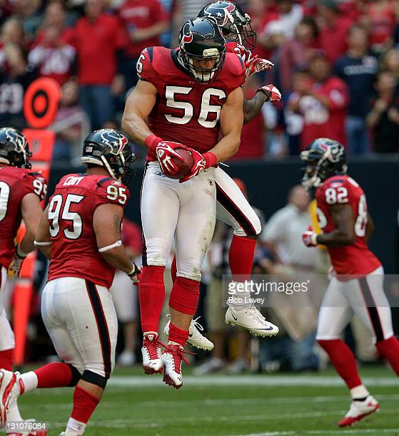 Linebacker Brian Cushing of the Houston Texans celebrates with Jason Allen and Johnathan Joseph after making an interception against the Jacksonville...
