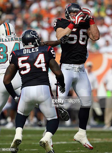 Linebacker Brian Cushing of the Houston Texans intercepts a pass intended for Ricky Williams of the Miami Dolphins at Land Shark Stadium on December...