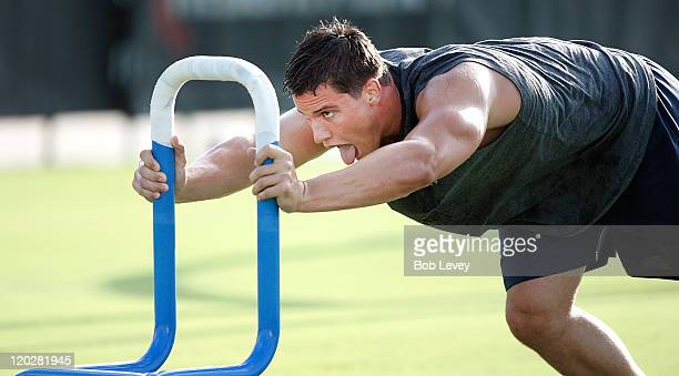 Linebacker Brian Cushing of the Houston Texans pushes a weight sled during morning practice during training camp at the Methodist Training Center at...