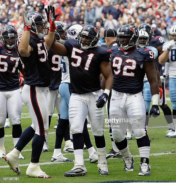 Linebacker Brian Cushing of the Houston Texans receives a pat on the head from Darryl Sharpton after making a stop against the Tennessee Titans at...