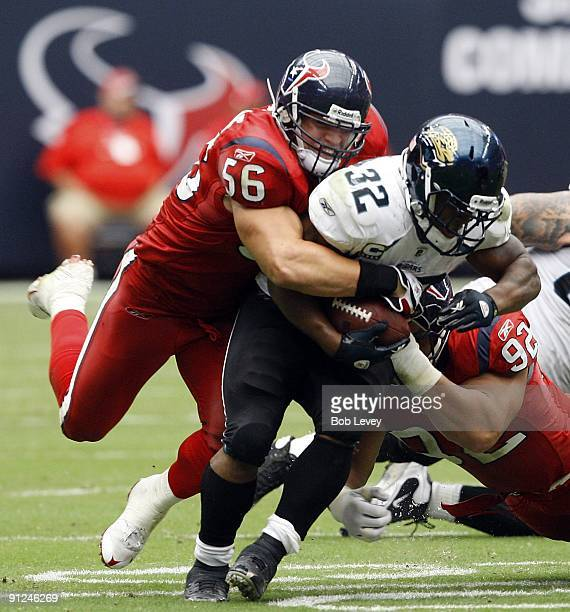 Linebacker Brian Cushing of the Houston Texans tackles running back Maurice JonesDrew of the Jacksonville Jaguars during the game at Reliant Stadium...