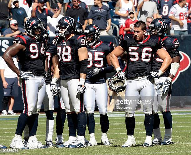 Linebacker Brian Cushing of the Houston Texans takes a break along with defensive end Connor Barwin and Antonio Smith during the game against the San...
