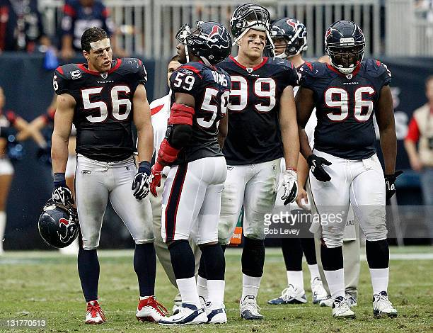 Linebacker Brian Cushing talks with DeMeco Ryans of the Houston Texans as JJ Watt and Tim Jamison stand by at Reliant Stadium on November 6 2011 in...