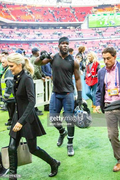 Linebacker Brian Orakpo leaves the field behind Sportscaster Melissa Stark after the NFL game between the Tennessee Titans and the Los Angeles...