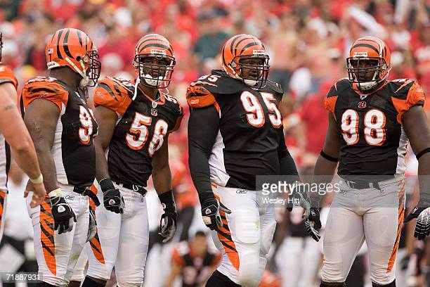 Linebacker Brian Simmons defensive tackle Sam Adams and defensive end Bryan Robinson of the Cincinnati Bengals stand on the field during a game...