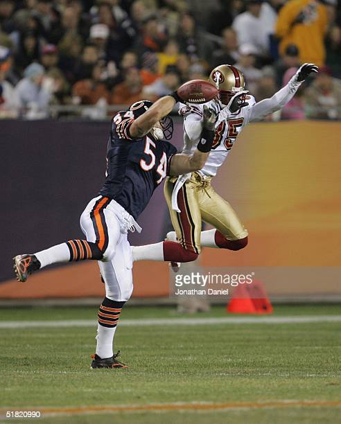 Linebacker Brian Urlacher of the Chicago Bears breaks-up a pass intended for wide receiver Brandon Lloyd of the San Francisco 49ers during the game...