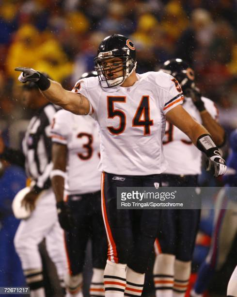 Linebacker Brian Urlacher of the Chicago Bears gestures against the New York Giants at Giants Stadium on November 12, 2006 in East Rutherford, New...