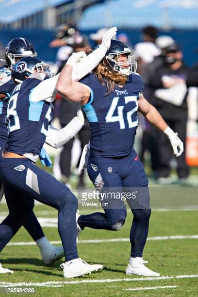Linebacker Brooks Reed of the Tennessee Titans celebrates after sacking the quarterback during their AFC Wild Card Playoff game against the Baltimore...