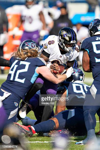 Linebacker Brooks Reed of the Tennessee Titans sacks Lamar Jackson of the Baltimore Ravens during their AFC Wild Card Playoff game at Nissan Stadium...