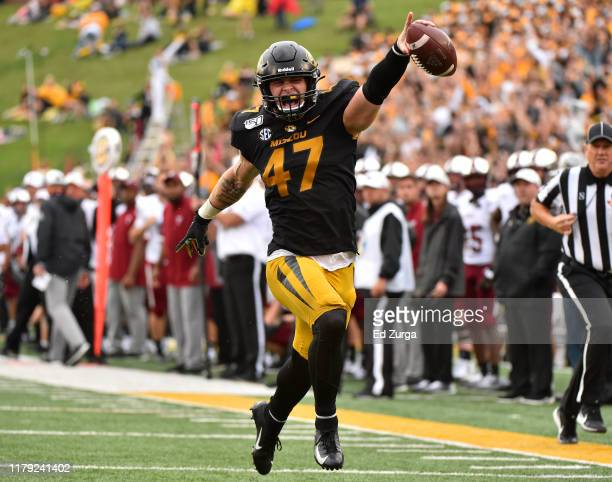 Linebacker Cale Garrett of the Missouri Tigers celebrates as he runs for touchdown after intercepting a pass against the Troy Trojan sin the second...