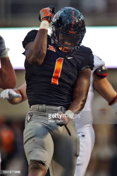 Linebacker Calvin Bundage of the Oklahoma State Cowboys celebrates his tackle stopping the South Alabama Jaguars from converting on third down in the...