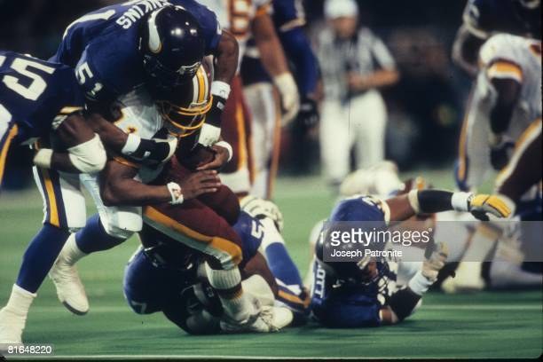Linebacker Carlos Jenkins of the Minnesota Vikings stops running back Earnest Byner of the Washington Redskins in the 1992 NFC Wildcard Game at the...