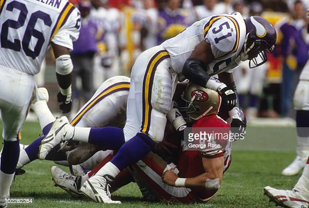 Linebacker Carlos Jenkins of the Minnesota Vikings takcles San Francisco 49ers tight end Brent Jones during the game at Candlestick Park on October 3...